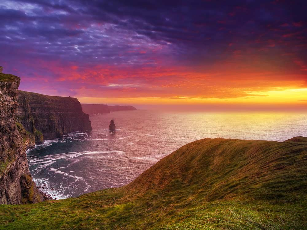 Witness the magical sunset at Cliffs of Moher