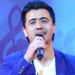 دانلود آهنگ شاد تاجیکی حنا دختر دروازی با صدای ولی جان عزیزوف